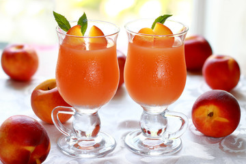 Two glass of fresh juice from ripe fruits