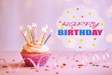 Fototapety Delicious birthday cupcake on table on bright background