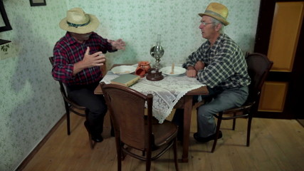 Total shot of farmers talking at the table in medieval times
