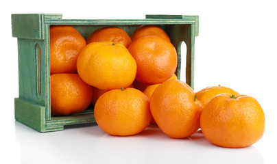 Tangerines in wooden box isolated on white
