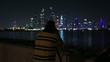 photographer shooting at night city Dubai