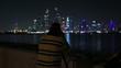 photographer shooting at night city Dubai