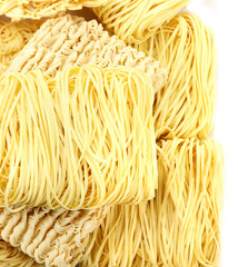 Different dry instant noodles isolated on white