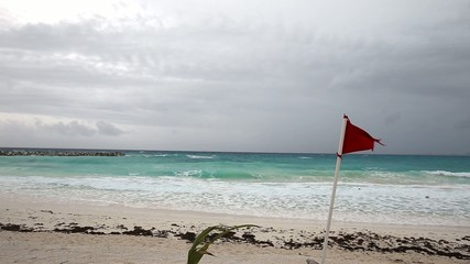 Lifeguard red flag on caribbean beach in bad weather, Cancun, Me