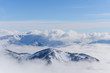 View on mountains and blue sky above clouds - 77587962