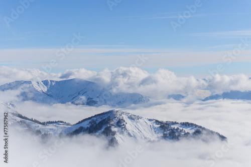 Leinwandbild Motiv View on mountains and blue sky above clouds