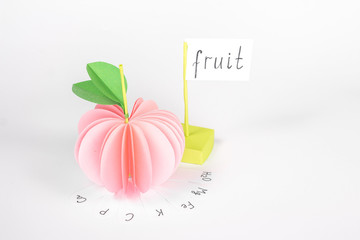 """paper apple with vitamin and card with word """"fruit"""""""