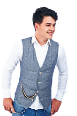 Young handsome man hands on the belt looking away and smiling on