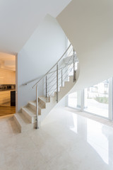 Staircase inside beige apartment
