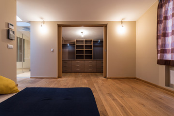 Bedroom with wardrobe in the apartment