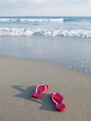 Beach sandals towards the sea