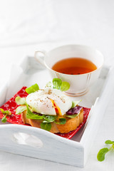 poached egg on crispy toast with green salad