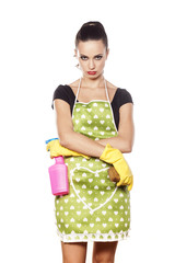 Unhappy young housewife standing on a white background