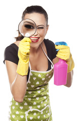 Smiling woman with rubber gloves, looking through magnifyer