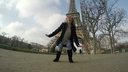 Woman in Paris jumping in slow motion