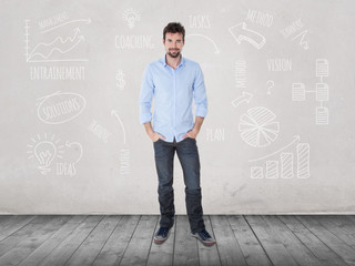 young man standing up in front of financial sketches