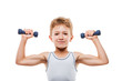 Smiling sport child boy with strong biceps muscles holding exerc