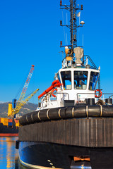 Tugboat and Containers Ship