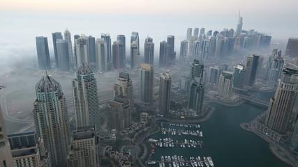 time lapse aerial view skyscraper foggy weather Dubai
