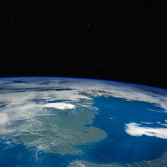 Great Britain from space with stars above.