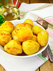 Potatoes fried on plate on table