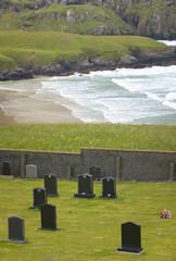 Scottish landscape with graveyard and coastline. Scotland. UK