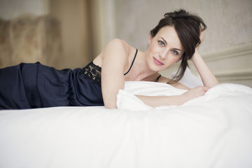 Portrait of a beautiful woman lying on the bed