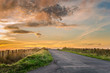 Leinwanddruck Bild - Sunset over a Country Road