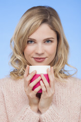 Portrait of a beautiful woman holding a coffee cup