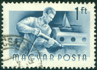 stamp printed in Hungary shows Riveter
