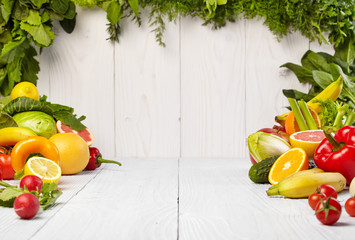 frame with fresh organic vegetables and fruits on wooden backgro