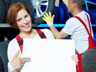 Female apprentice shows blackboard