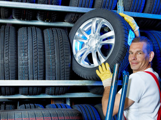 Car mechanic stores tires