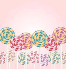 Multicolored lollipops on pink background