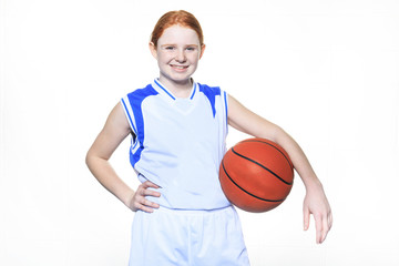 A teenager basketball player over a white background