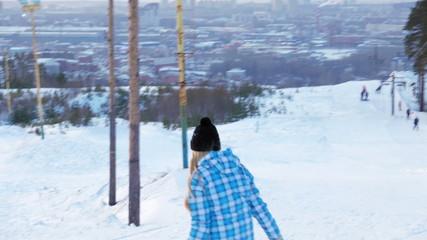 Girl goes down on sonuborde mountain. Russia