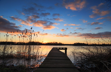 Small jetty during a colorful winter sunset.