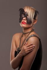 Butterfly mask beauty woman on grey background