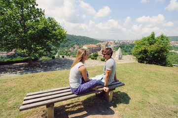 Couple in Sunglasses on Bench