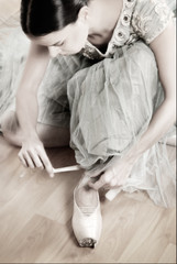 Ballerina Tying Pointe Shoes