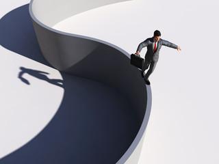businessman walking along a curved line