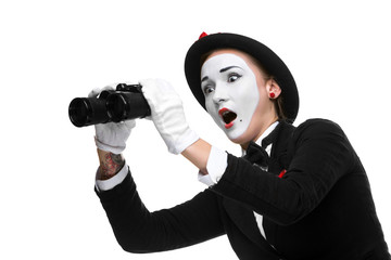 Portrait of the surprised and joyful mime with binoculars