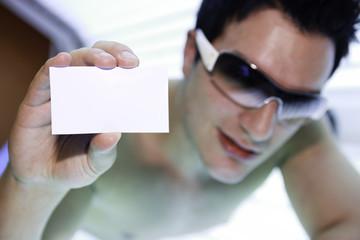 A man in a sunbath receiving high degree of ultraviolet light.