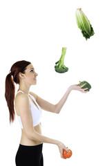 Woman juggle vegetable