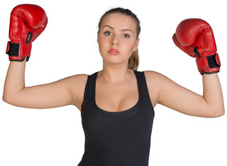 Woman in boxing gloves posing with her arms up