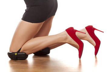 pretty female legs with high heels, and with knee protectors
