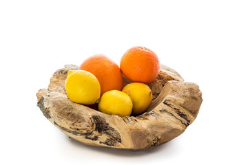 Wooden bowl with citrus