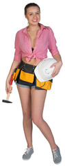 Woman in tool belt holding hard hat and hammer