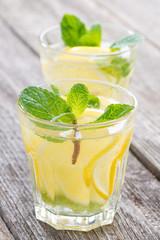 refreshing mint lemonade in glasses, close-up