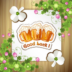 Wood background with clover and beer mugs